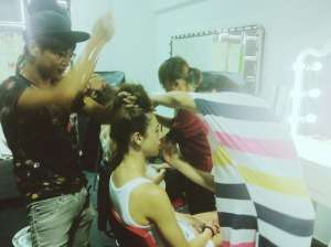 Make up artists and hair stylists prepping models for the shoot.