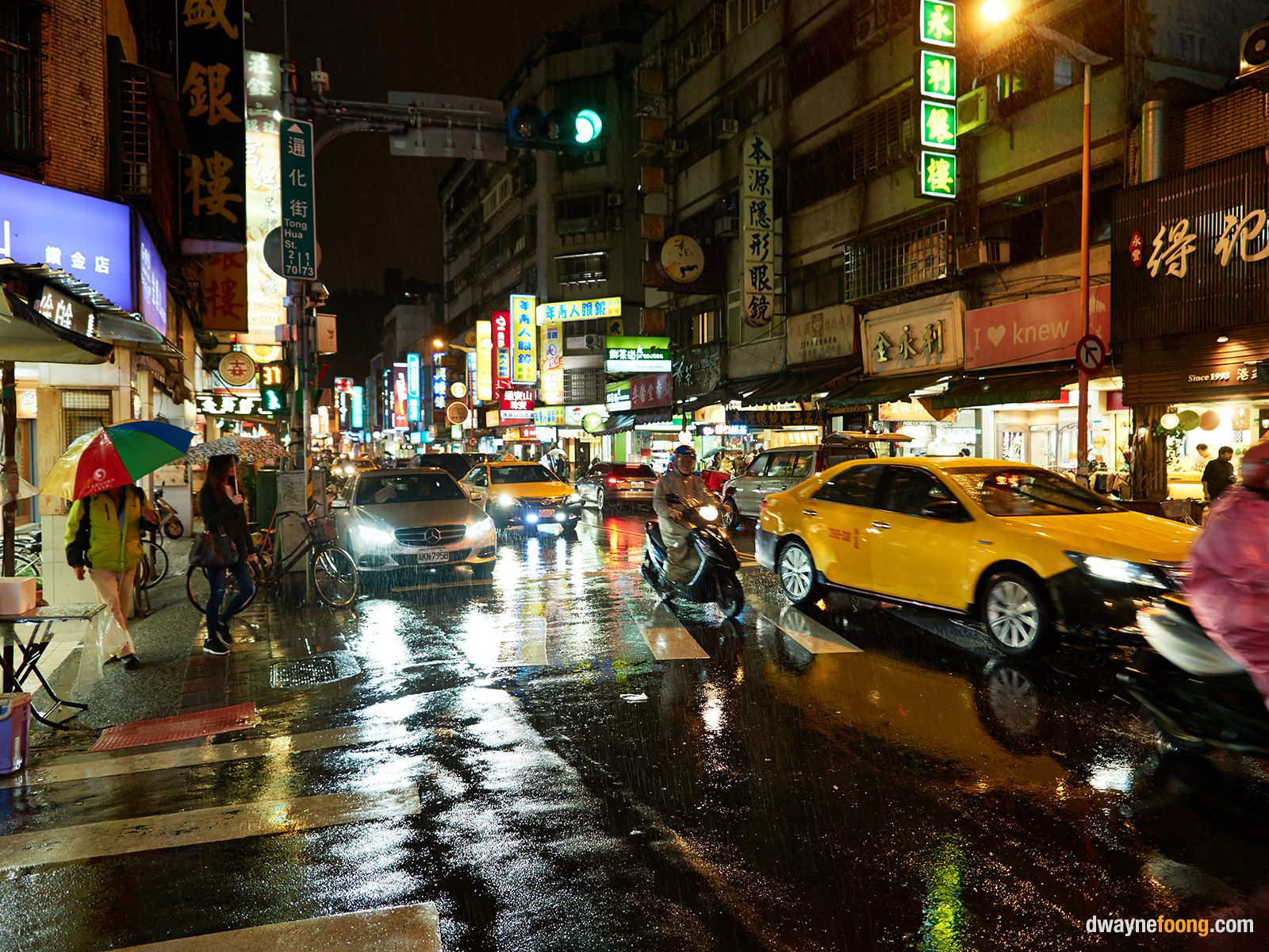 A view of Taipei City's street at night with rain.